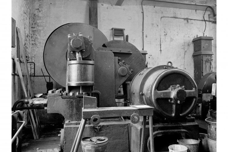 Glengarnock Steel Works, Joiner's Shop; Interior View of three-throw hydraulic pump for Buckton tensile testing machine - powered by Westinghouse motor-