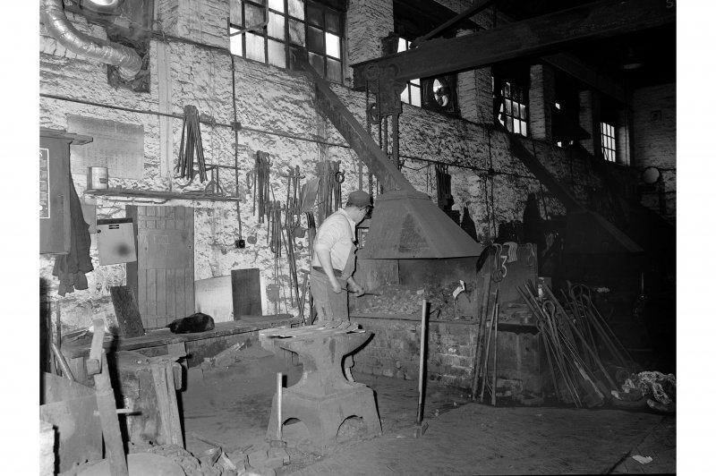 Glengarnock Steel Works, Smithy; Interior View of smith working at fires
