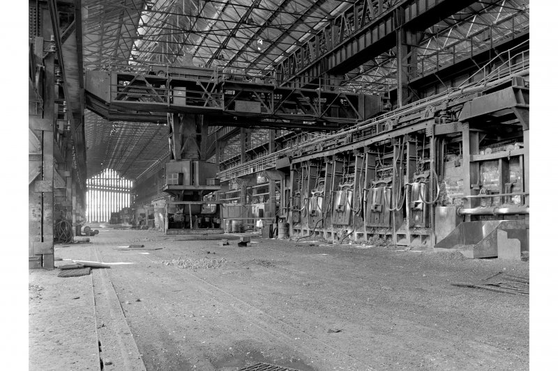 Glasgow, Clydebridge Steel Works, Interior View showing 90 ton fixed open-hearth furnace M with charging machine in background
