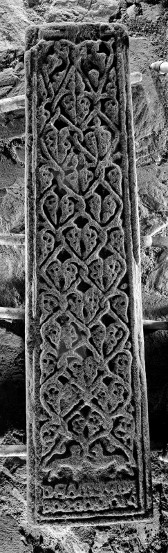 Oronsay Priory, grave slab. General view of grave-slab with plant stem pattern carving.
