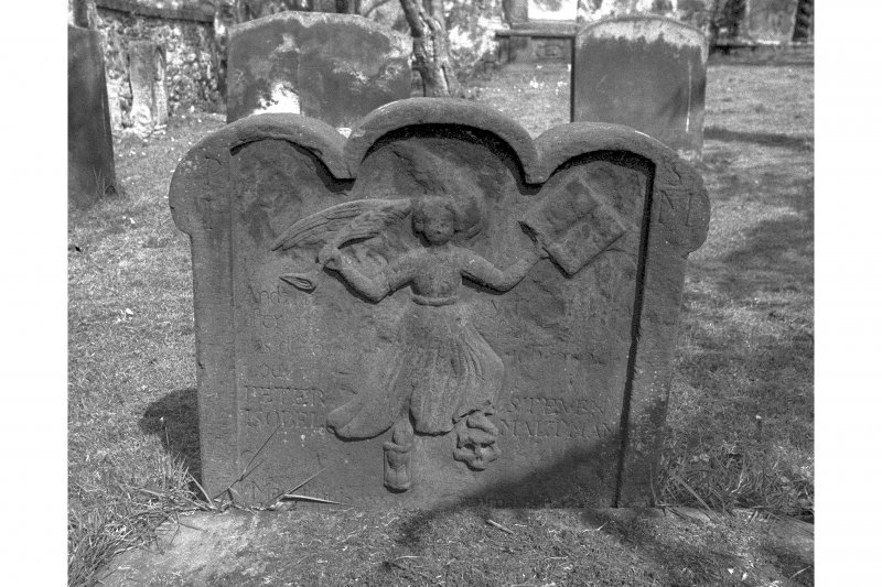 View of headstone for Peter Steven and Isobel Maltman, 1747: E face, showing dancing angel with book and trumpet in hands.