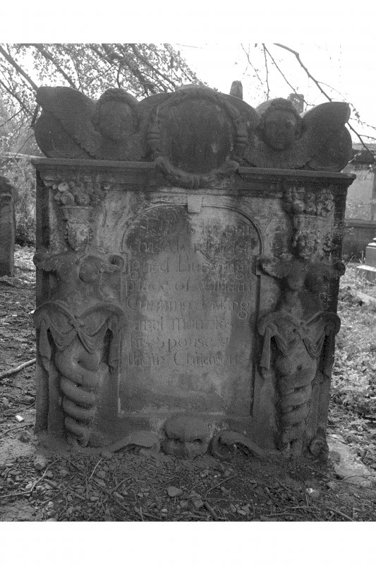 View of headstone for William Cumming, 1778: two caryatids with twisted columns, and above, twin souls with circlet.