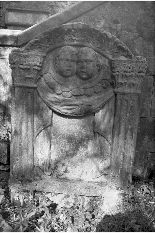 Glencorse old parish church Gravestone commemorating James Craigie, d.1713; pair of cherubs in pediment, inscription panel flanked by Corinthian pillasters.