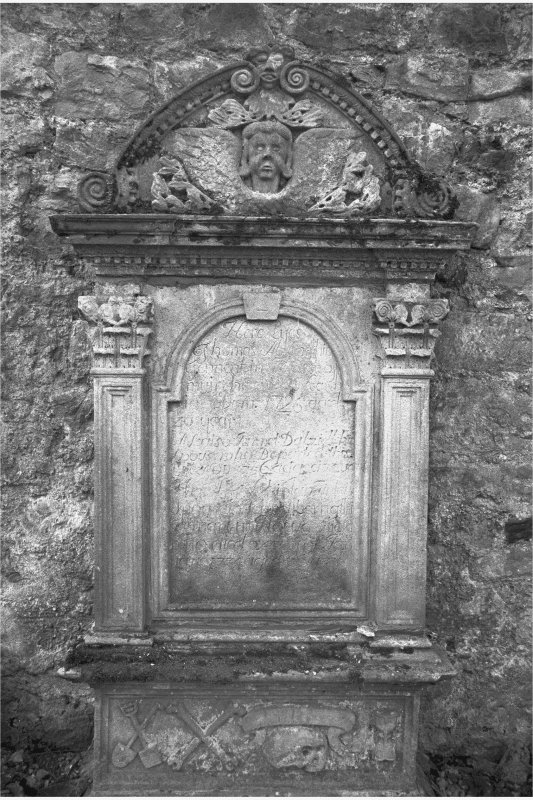 Glencorse old parish church Mural monument commemorating Thomas Abernethie, d.1726; Corinthian pillasters flanking inscription panel. Arched tympanum filled by winged cherub, with a 'Green Man' mask at top.
