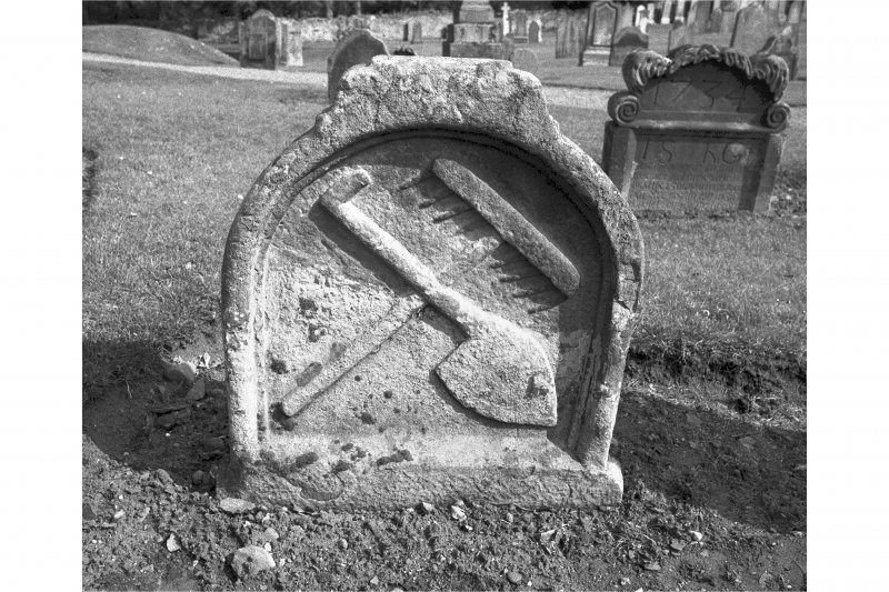 View from W of gravestone commemorating W B and M G d.1657; rake and shovel crossed.