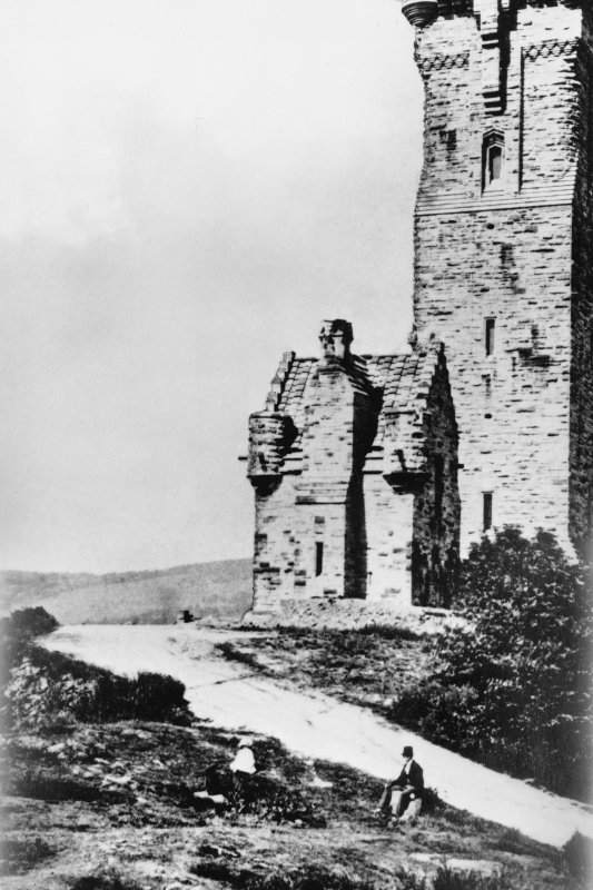 Glass plate negative of the exterior of the Wallace Monument with two figures in the foreground. Scanned image of [negative number to be supplied].
