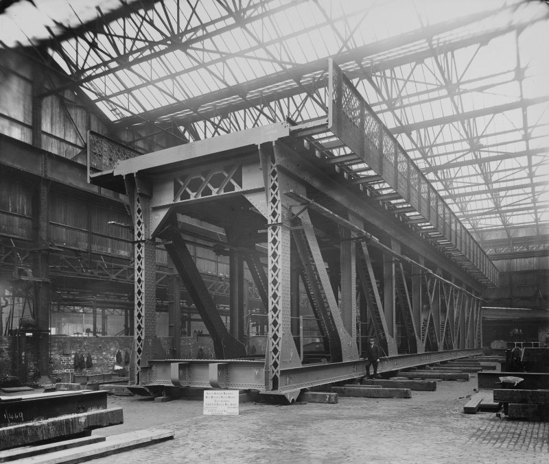 Ex-Scotland. Railway Bridge, New Buffalo River Bridge, East London, South Africa View interior of Arrol's Glasgow Works, bridge box section under assembly. Titled: 'South African Railways', 'New Buffalo River Bridge', 'East London', '3/155 0 Road and Rail spans', 'Ord[er] no. B5606', 'Ind no. 9M473', 'Contractors: Sir Wm Arrol & Co. Ltd., Glasgow', 'May 1933'. Stamped verso: 'The Dux Engraving Co Ltd, Glasgow', '[Negative no.] 1889/2'.