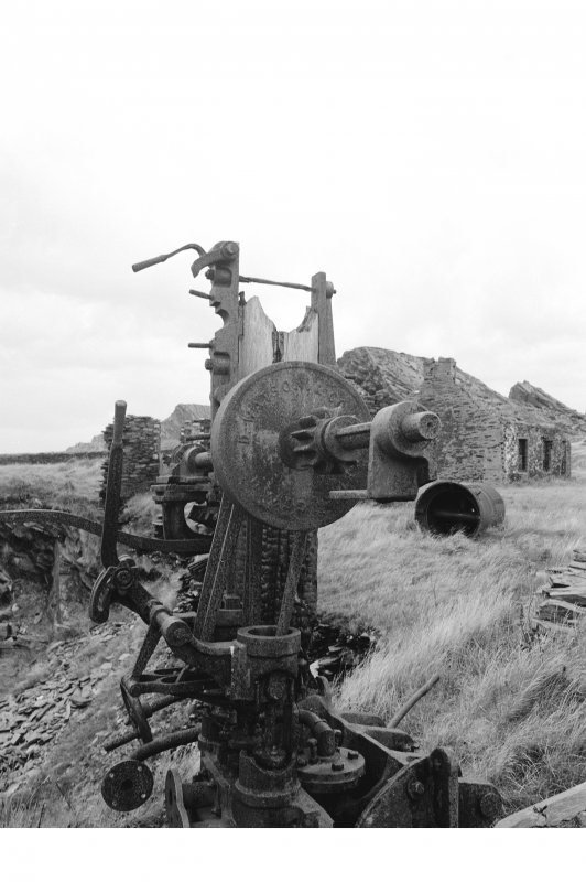 Belnahua Slate Quarry View of remains of steam driven derrick crane, boiler in background