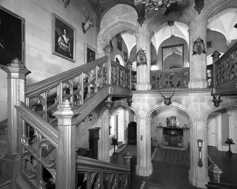 Interior view of arcade and oak staircase in entrance hall at Minard Castle from south.