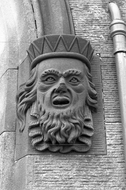 Castle Toward, South Lodge. Detail of grotesque mask stop at South-East window of South Lodge.
