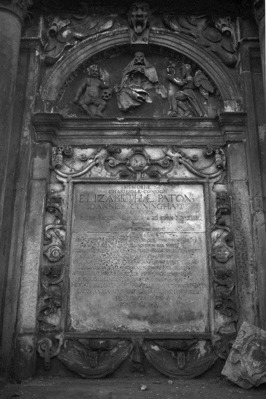Detail of monument to Elizabeth Paton dated 1676 with robed skeleton in tympanum at top.