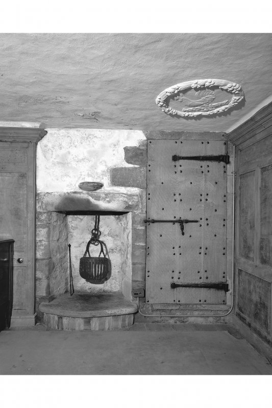 Dunderave Castle, interior. View of fireplace in chamber on fourth floor of South wing.