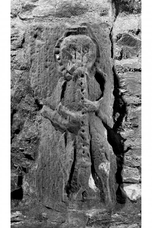 Detail of carved musician on East side of main entrance doorway, Dunderave Castle.