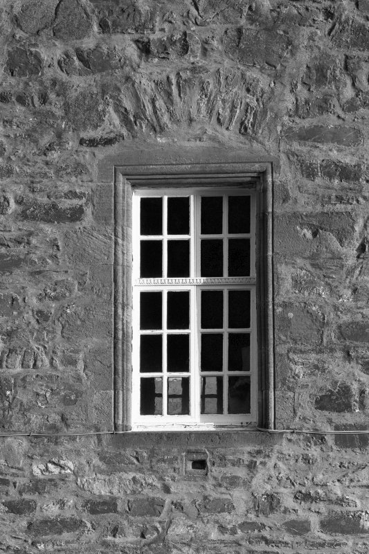 Dunderave Castle View of first floor window and pistol loop on North West wall.