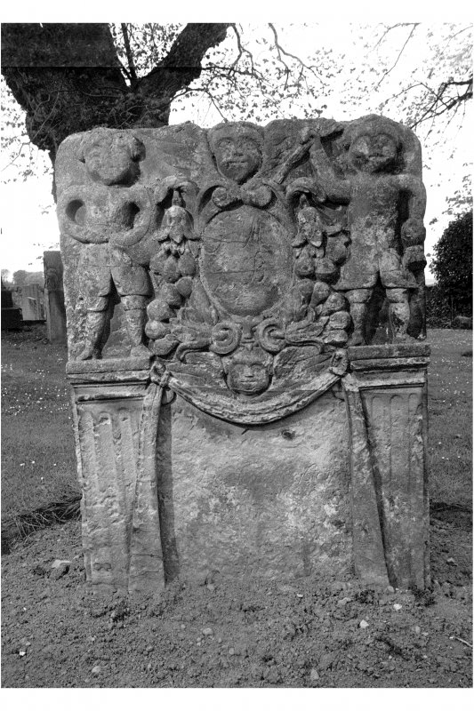 East Saltoun churchyard. Janet Begbie d.1765. Reverse face; cartouche flanked by figures of sower and harvester. Fruit pouring from flowers. Panel beneath bordered by pilasters.