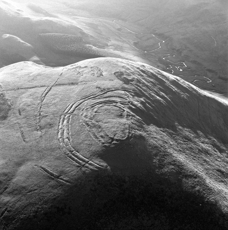 Oblique aerial view centred on Woden Law fort.