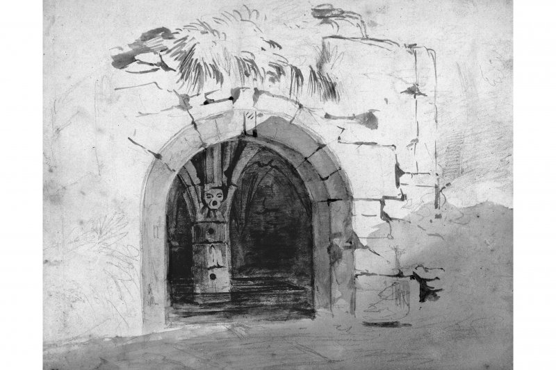 Photographic copy of a view into the well/Chapel, showing the carved face of the well mouth within. Sepia ink on paper.