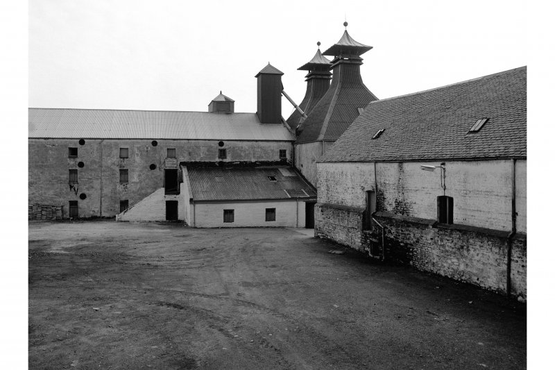 Islay, Ardbeg Distillery View of maltings (l) and malt deposit
