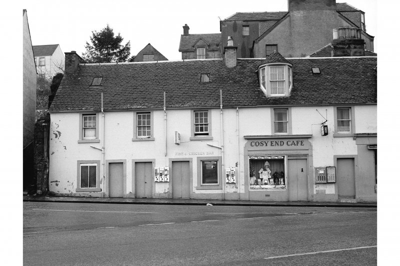 View of 1-9 Lower Bridge Street, Stirling, showing houses and shops including the Cosy End Cafe. View from ESE showing part of ESE front