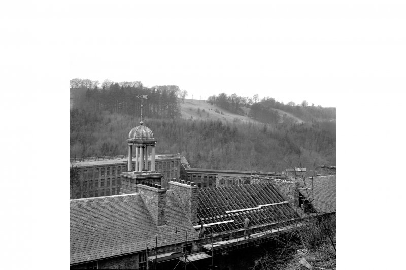 New Lanark, New Buildings View from E showing cupola and roof repairs with mill number 2 and mill number 1 in background