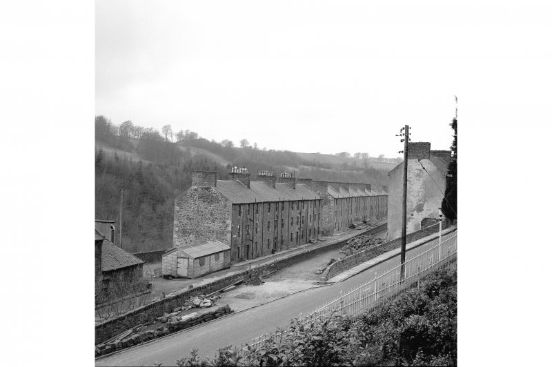 New Lanark, 9-47 Rosedale Street View from E showing ESE front of number 9 and NNE front of numbers 9-47 with numbers 49-127 in background
