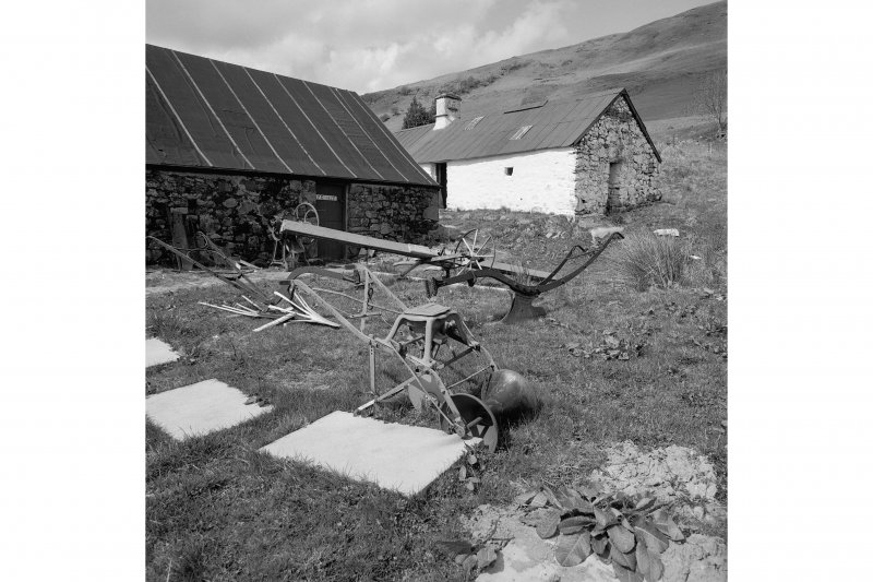 Auchindrain, Township View from SE showing seed drill and ploughs with part of N barn and N cottage and byre in background