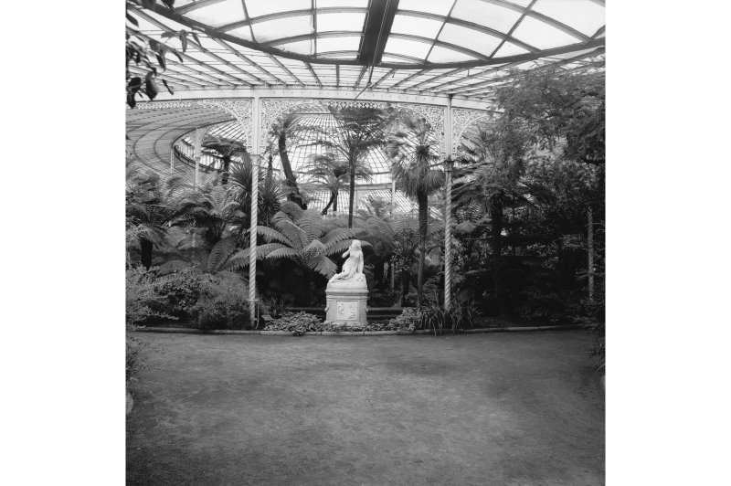 Interior. General view showing statue, plants and cast-iron columns and brackets.