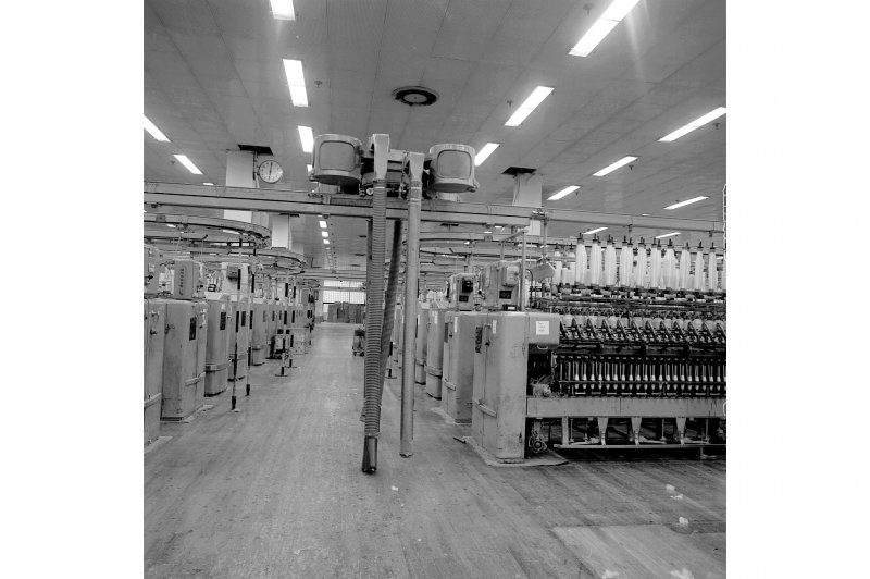 Paisley, Ferguslie Thread Mills, No. 3 Mill; Interior View of an 'elephant', a self-acting vacuum cleaner than runs above the rows of the spinning machines