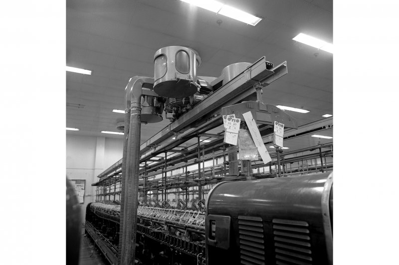 Paisley, Ferguslie Thread Mills, No. 3 Spinning Mill; Interior View of an 'elephant', a self acting vacuum cleaner which runs above spinning machines in 3rd flat