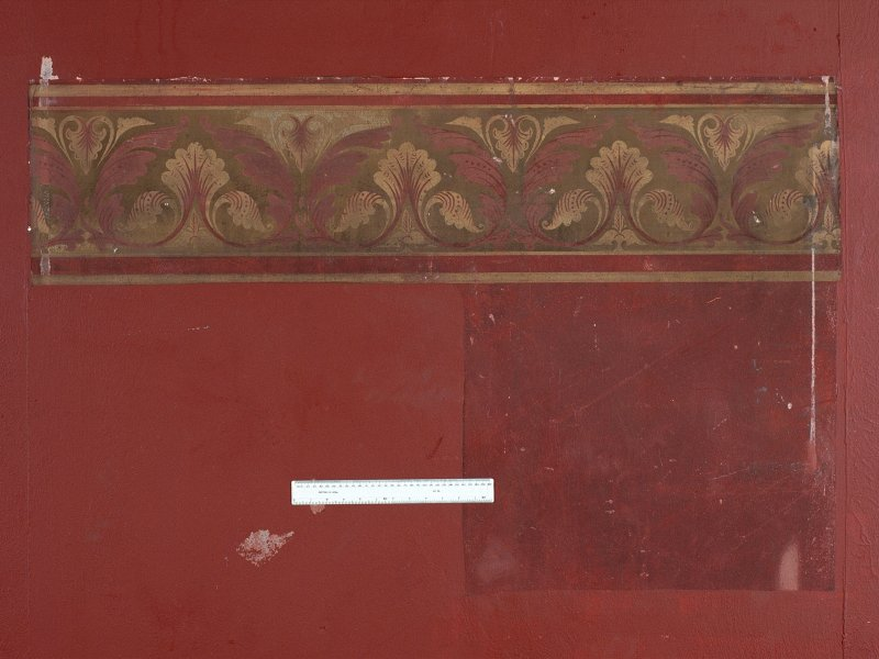 Interior. Nave, detail of revealed painted wall decoration on south wall.