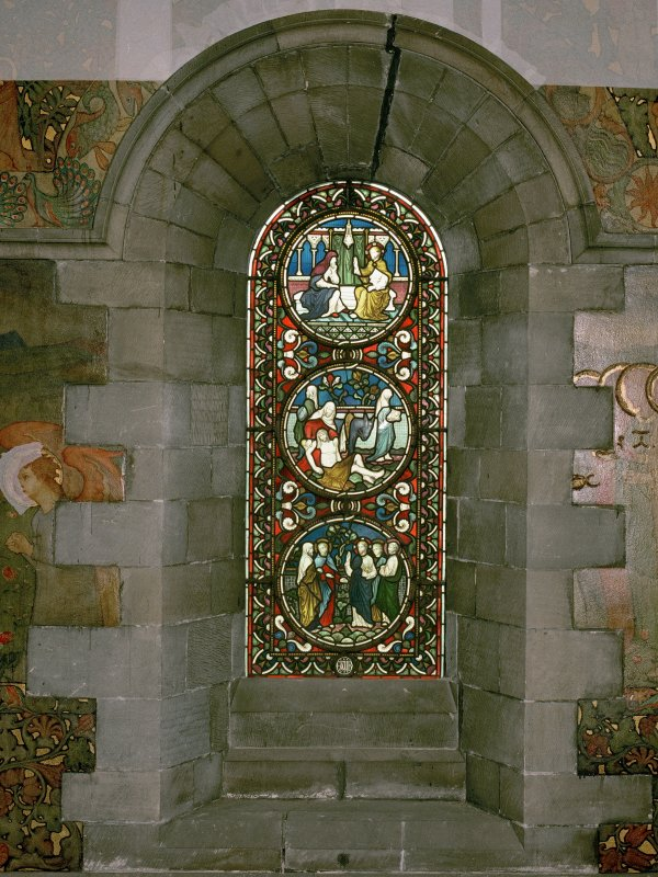 Interior. North chapel, stained glass window on north wall showing scenes from the life of Christ.