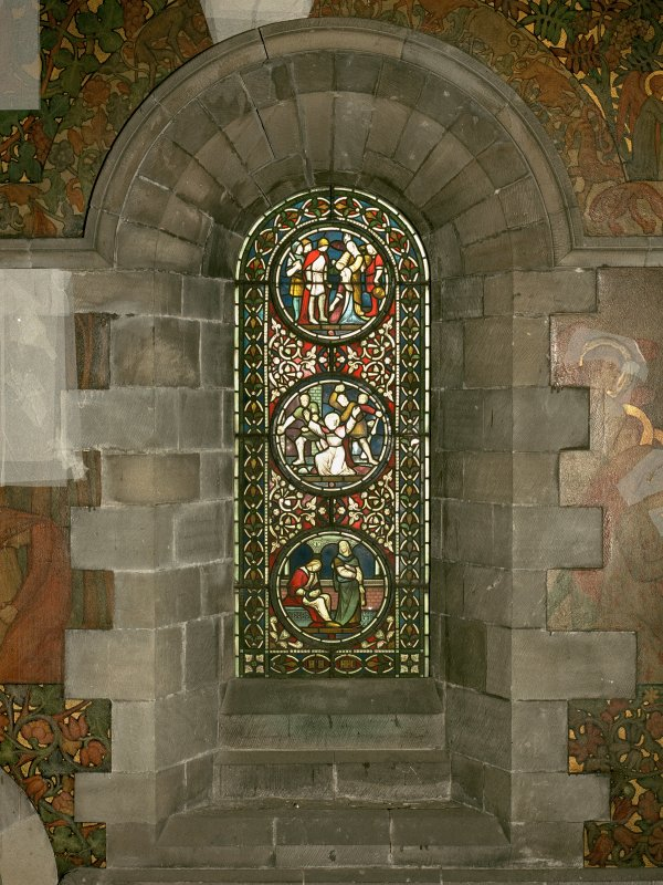 Interior. North chapel, stained glass window on north wall showing scenes from the lives of the Saints.