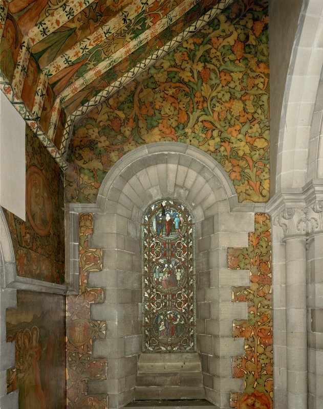 Interior. North chapel, view of mural on east wall and stained glass window.