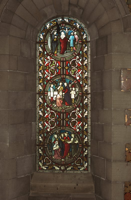 Interior. North chapel, view of stained glass window on east wall.