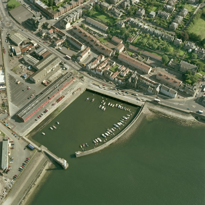 Oblique aerial view from North-West centred on Newhaven Harbour.
