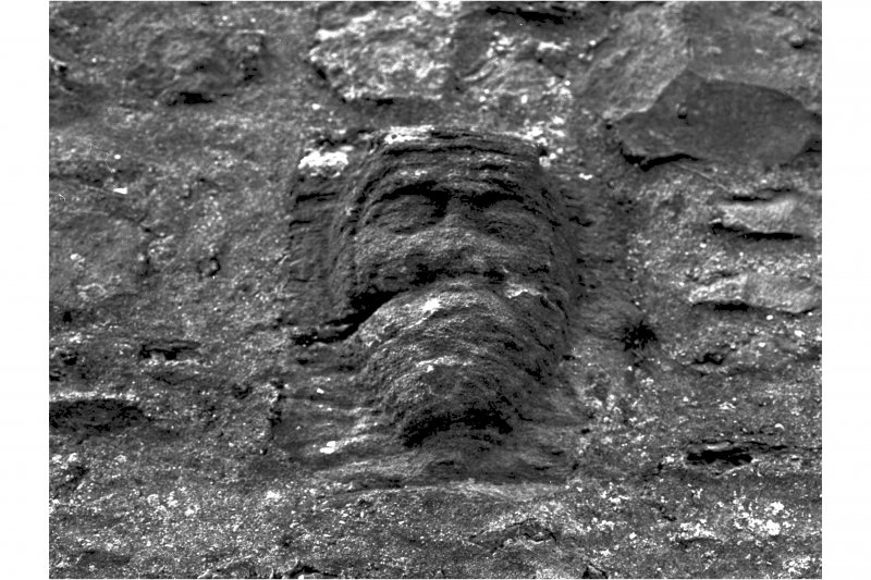 View of corbel head on North East wall of Keep at second floor level Plate 64C