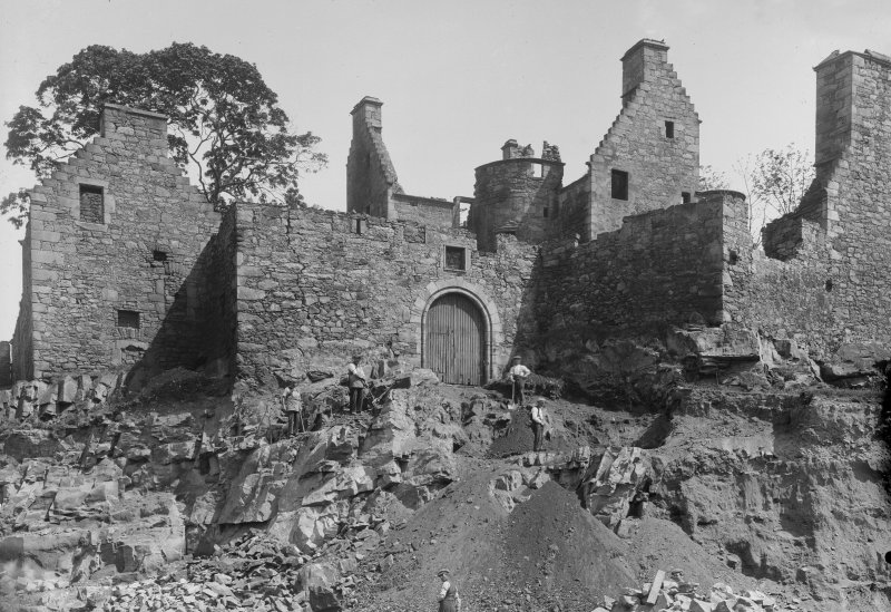 View of castle with men digging