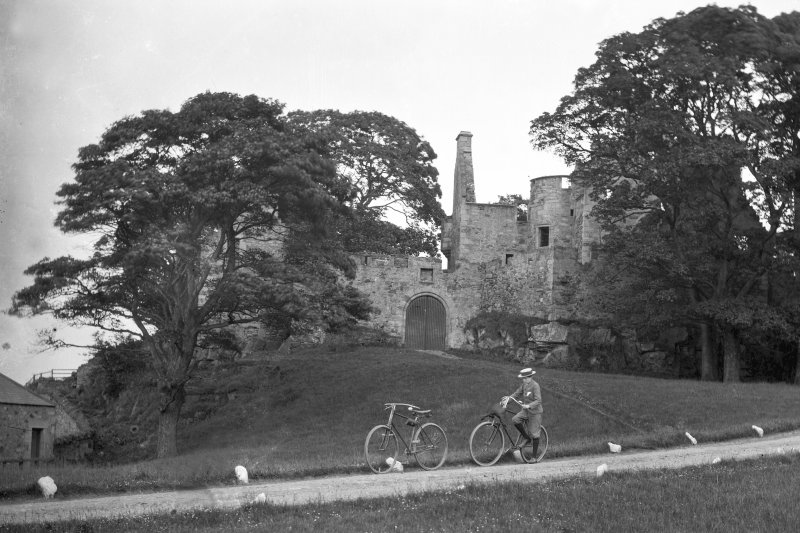 View of castle with boy on bicycle