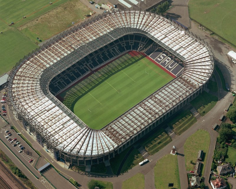 Edinburgh, Murrayfield Stadium, oblique aerial view, taken from the ESE, centred on Murrayfield Stadium. Murrayfield Ice Rink is visible in the top centre half of the photograph.