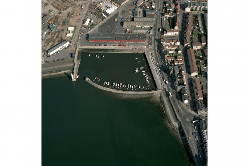 Oblique aerial view from West centred on Newhaven Harbour.