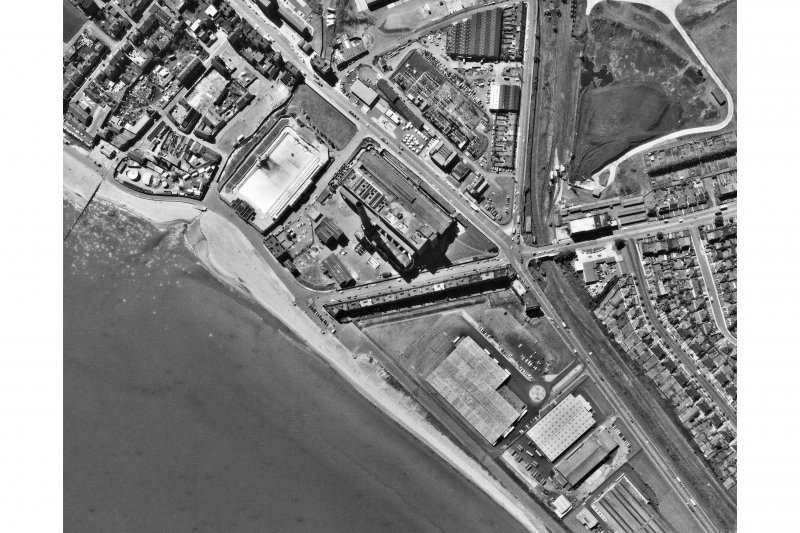 Scanned image of vertical aerial photograph BKS 2275: 135 Showing Portobello, including Portobello Power Station and Portobello Open Air Swimming Pool. Date: 1973
