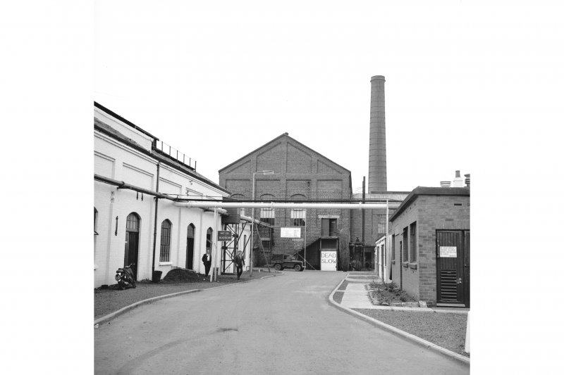 Cardowan Colliery View from W showing W front of engine house with chimney in background and works buildings in foreground