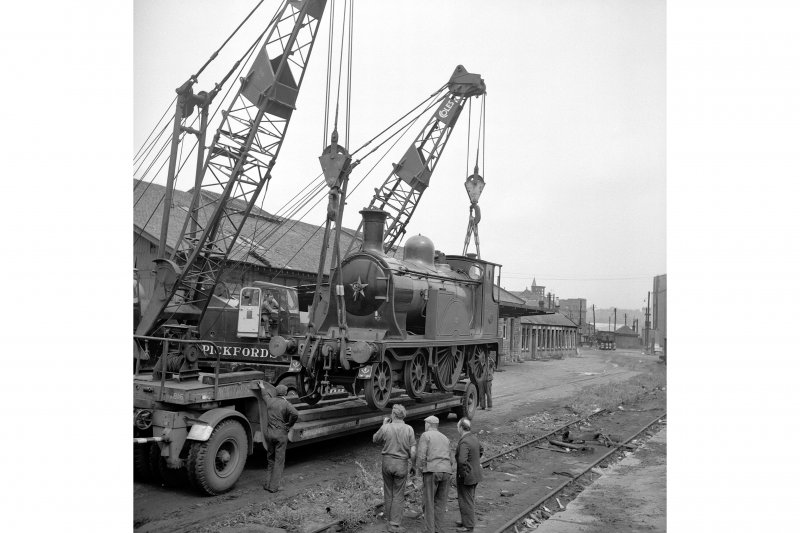 Glasgow, Govan Goods Yard View from S showing cranes lifting locomotive number 123 with loading shed in background