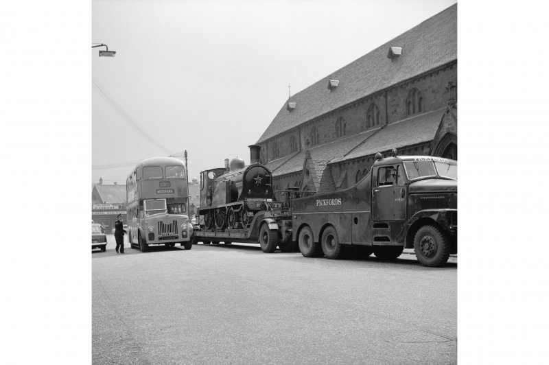 View from NW showing locomotive number 123 on trailer outside St Ninian's Episcopal Church, Pollokshaw Road, Glasgow.