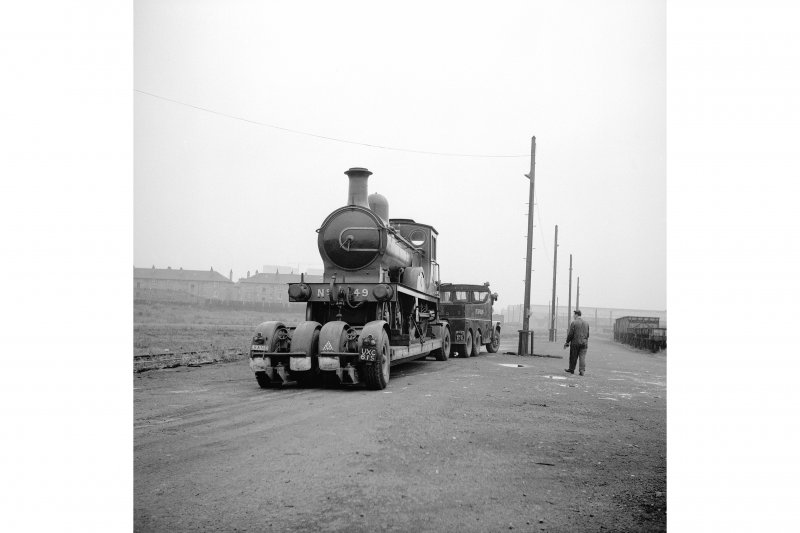 Glasgow, Govan Goods Yard View showing locomotive number 49 on trailer with trucks on right