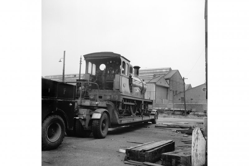 Glasgow, Govan Goods Yard View from E showing locomotive number 49 on trailer with part of Glasgow Railway Engineering Works in background