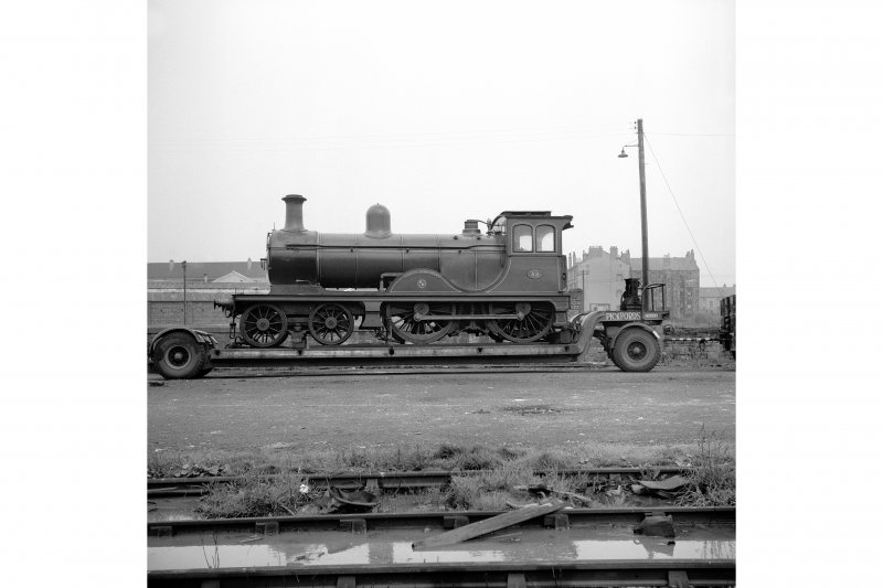 Glasgow, Govan Goods Yard View showing locomotive number 49 on trailer with railway tracks in foreground