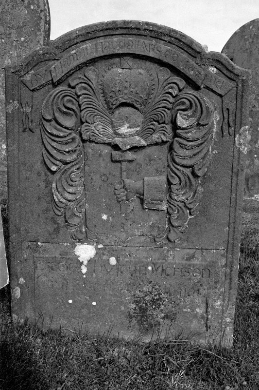 Gravestone commemorating Ninian Morison, d.1725. 'By Hammer in Hand all Arts do Stand'; royal crown, hand holding hammer.