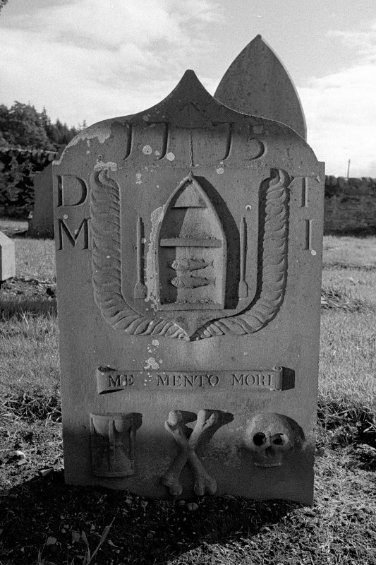Aberdalgie Old Parish Church. Gravestone commemorating Margaret Imbrie, d.1775. Boat containing two fish; intials D T and M I; 'MOMENTO MORI' scroll, hourglass, crossbones and skull.