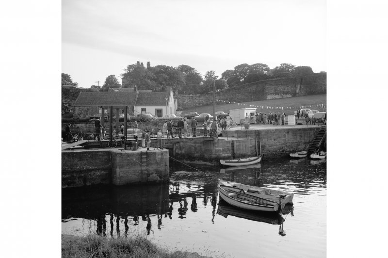 St Andrews Harbour, Rolling Suspension Footbridge View from ENE showing NNE front of bridge with store in background